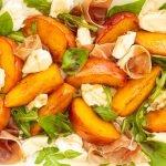 close up photo of caramelized peach caprese salad