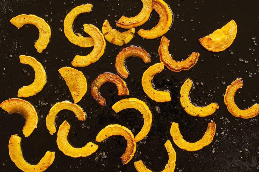 a sheet pan with oven roasted delicata squash