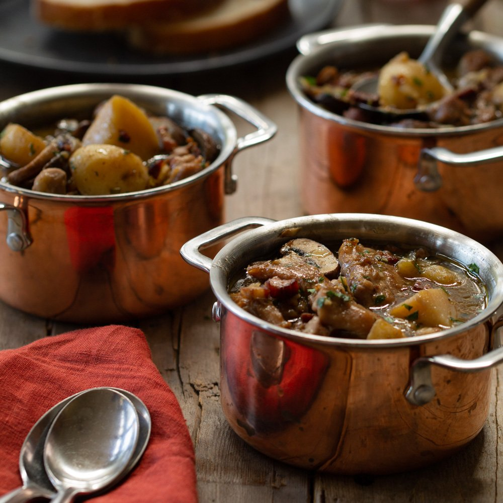 three copper coquettes filled with hearty chicken stew