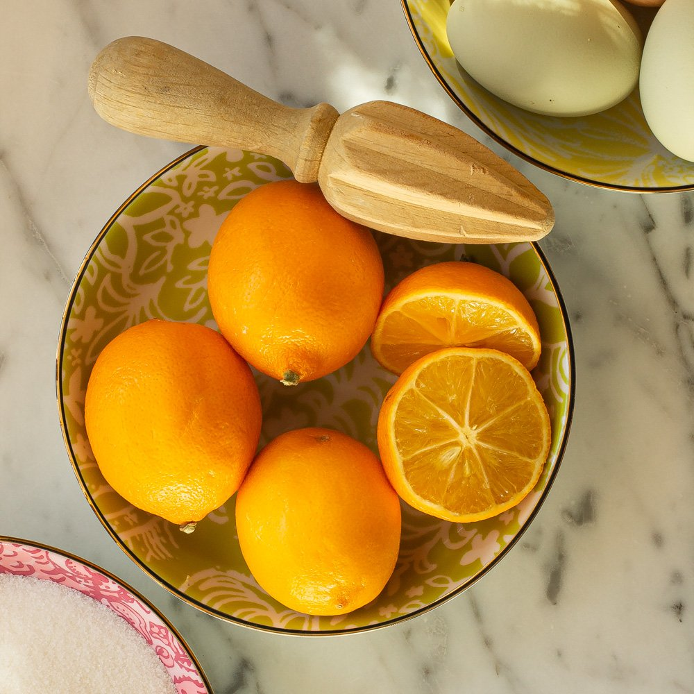 a bowl of Meyer Lemons with a citrus reamer