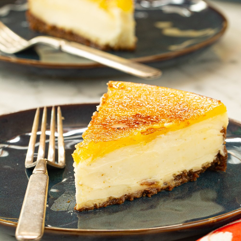 a slice of cheesecake with a fork on a plate