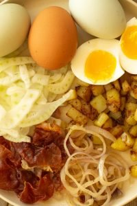 components of a Savory Breakfast Salad - 7-minute eggs, shaved fennel, browned potatoes an shallots, and crispy prosciutto