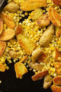 a sheet pan of roasted potatoes and corn