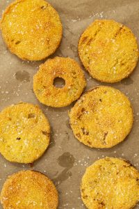fried green tomatoes on brown parchment paper