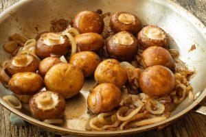 cremini mushrooms and shallots in a large saute pan